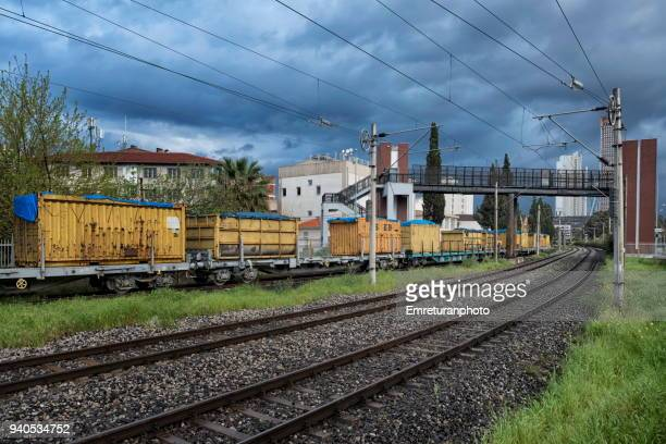 railroad track with freight wagons. - emreturanphoto stock pictures, royalty-free photos & images