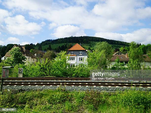 Railroad Track With Houses In Background