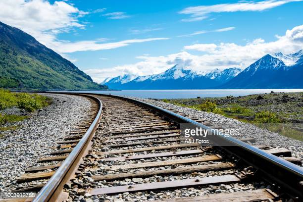 railroad track with mountain range and fjord - rail transportation stock pictures, royalty-free photos & images