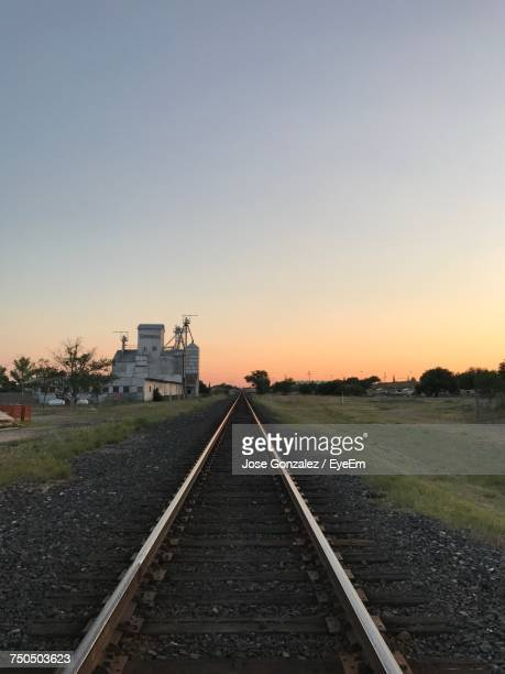 Railroad Tracks Against Clear Sky During Sunset