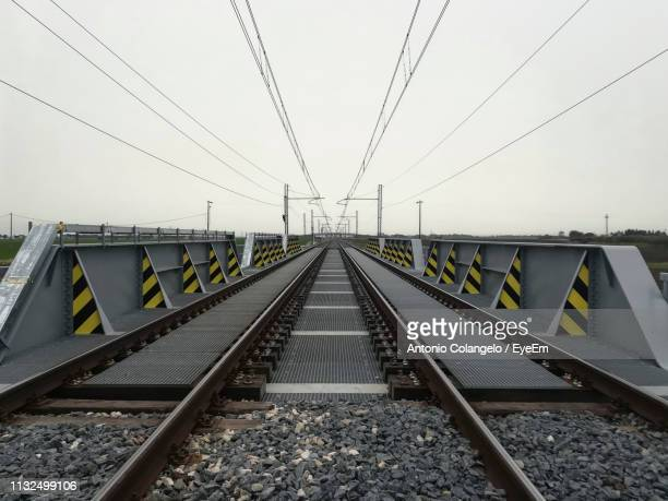 railroad tracks against clear sky - parallel stock pictures, royalty-free photos & images