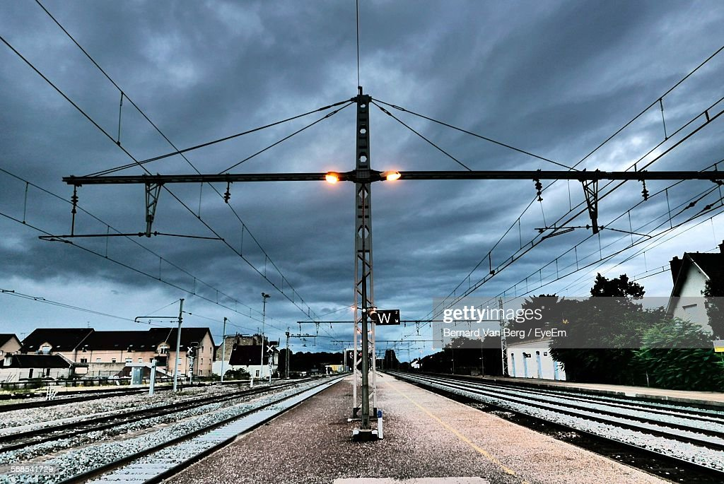 Railroad Tracks Against Cloudy Sky : Stock Photo