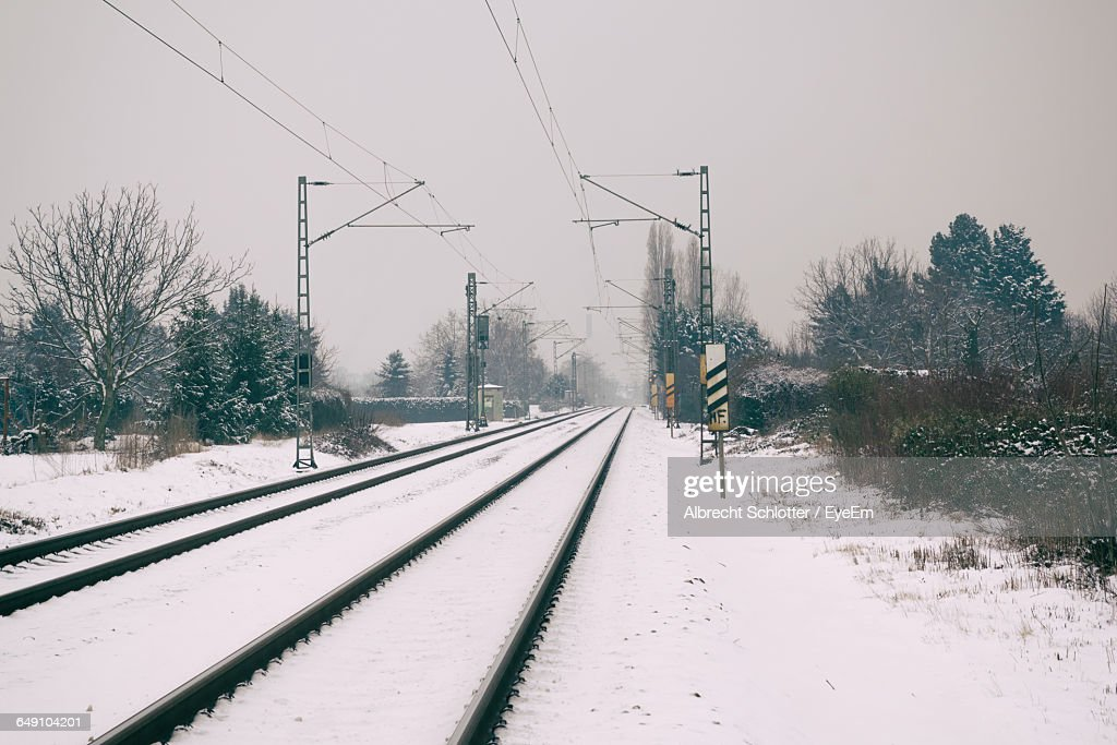 Railroad Tracks Against Sky During Winter : Stock-Foto