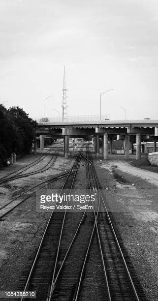 railroad tracks against sky - tulsa stock pictures, royalty-free photos & images