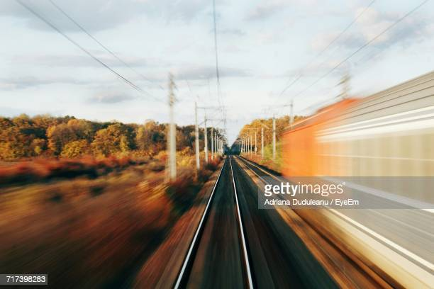 railroad tracks against sky - adriana duduleanu stock photos and pictures