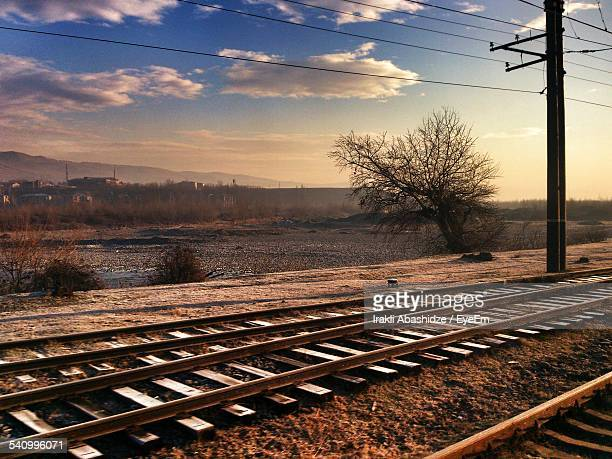 Railroad Tracks And Landscape Against Sky
