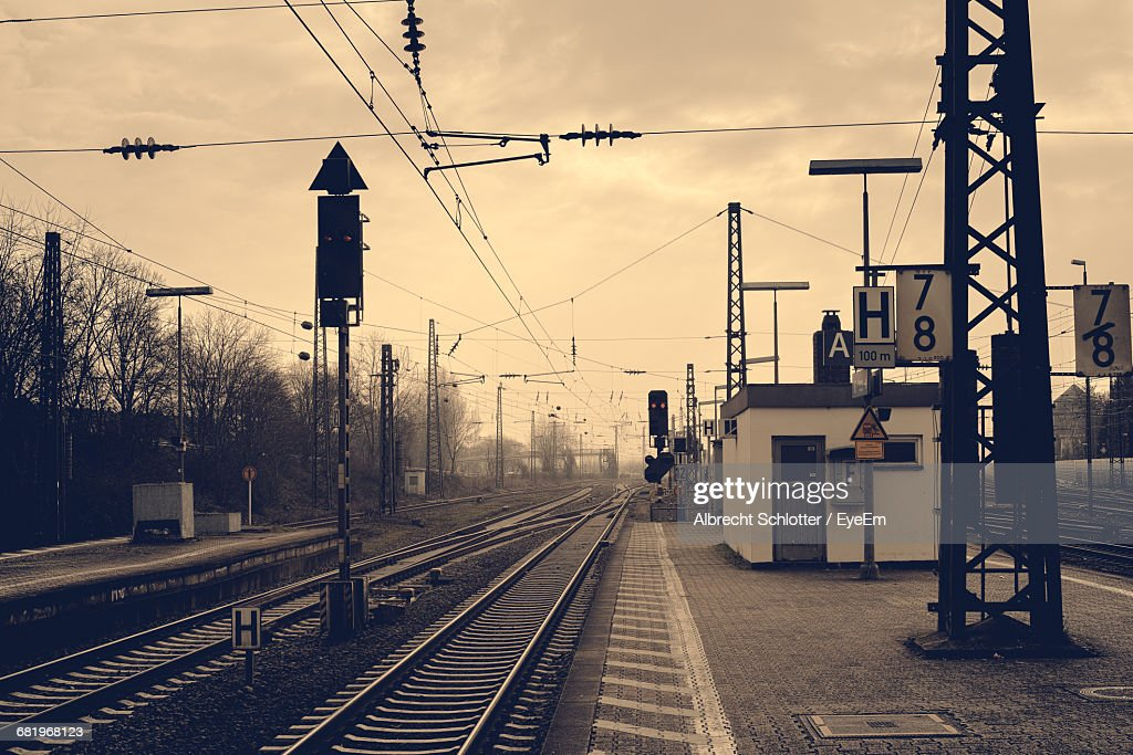 Railroad Tracks At Station Against Sky : Stock-Foto
