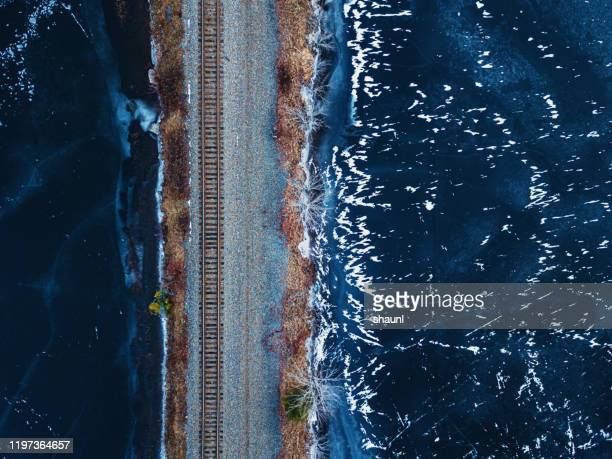 railroad tracks below - northern rail stock pictures, royalty-free photos & images