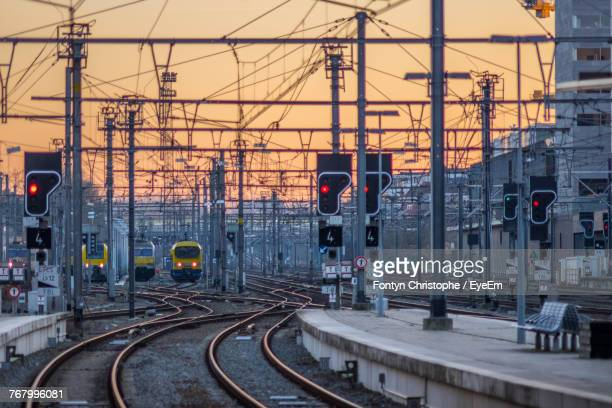 railroad tracks in city against sky - belgium stock pictures, royalty-free photos & images