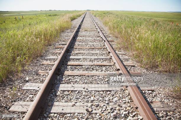 railroad tracks in countryside - climat stock pictures, royalty-free photos & images
