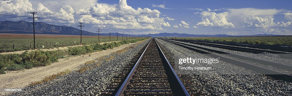 Railroad tracks, power lines and landscape beyond. : Stock Photo