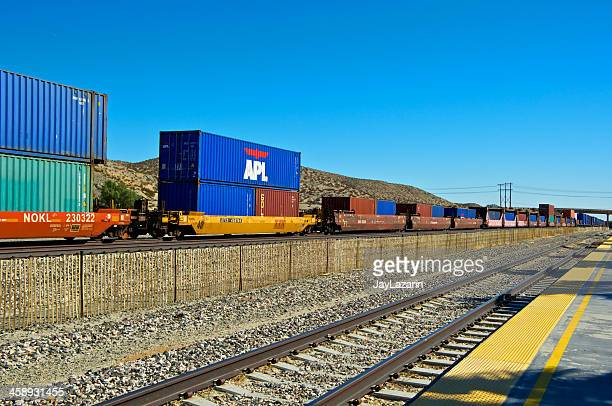 railroad train freight container carriers, palm springs, california - rail freight stock pictures, royalty-free photos & images