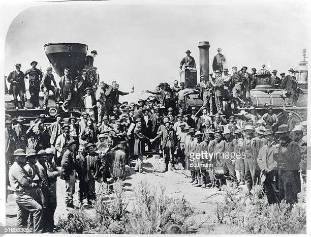 Railroad workers celebrate at the driving of the Golden Spike Ceremony in Utah on May 10 1869 signifying completion of the first transcontinental...