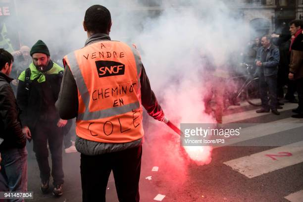 A railroader holds a smoke and carries the massage For sale SNCF railroader angry on his vest at the demonstration against the breakup of the public...