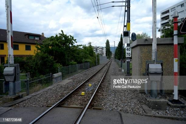 railroads and level barrier at nidau, switzerland - 待避所標識 ストックフォトと画像