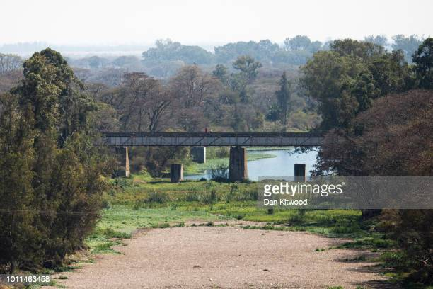 A railway bridge crosses the main tributary leading from Lake Chivero on August 5 2018 in Harare Zimbabwe Lake Chivero is 32km South West of...