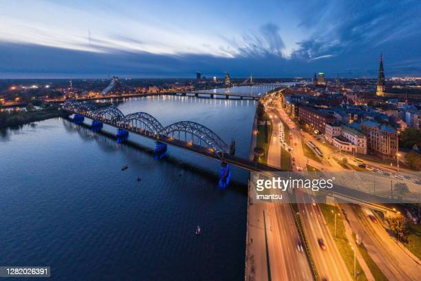 railway bridge in riga - capital cities stock pictures, royalty-free photos & images