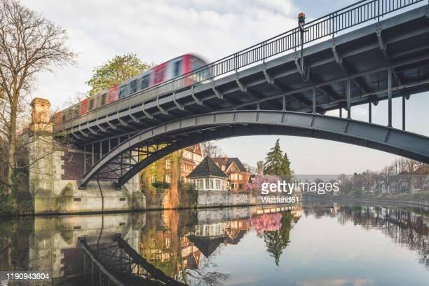 railway bridge over alster lake at hamburg, germany - hamburg stock-fotos und bilder