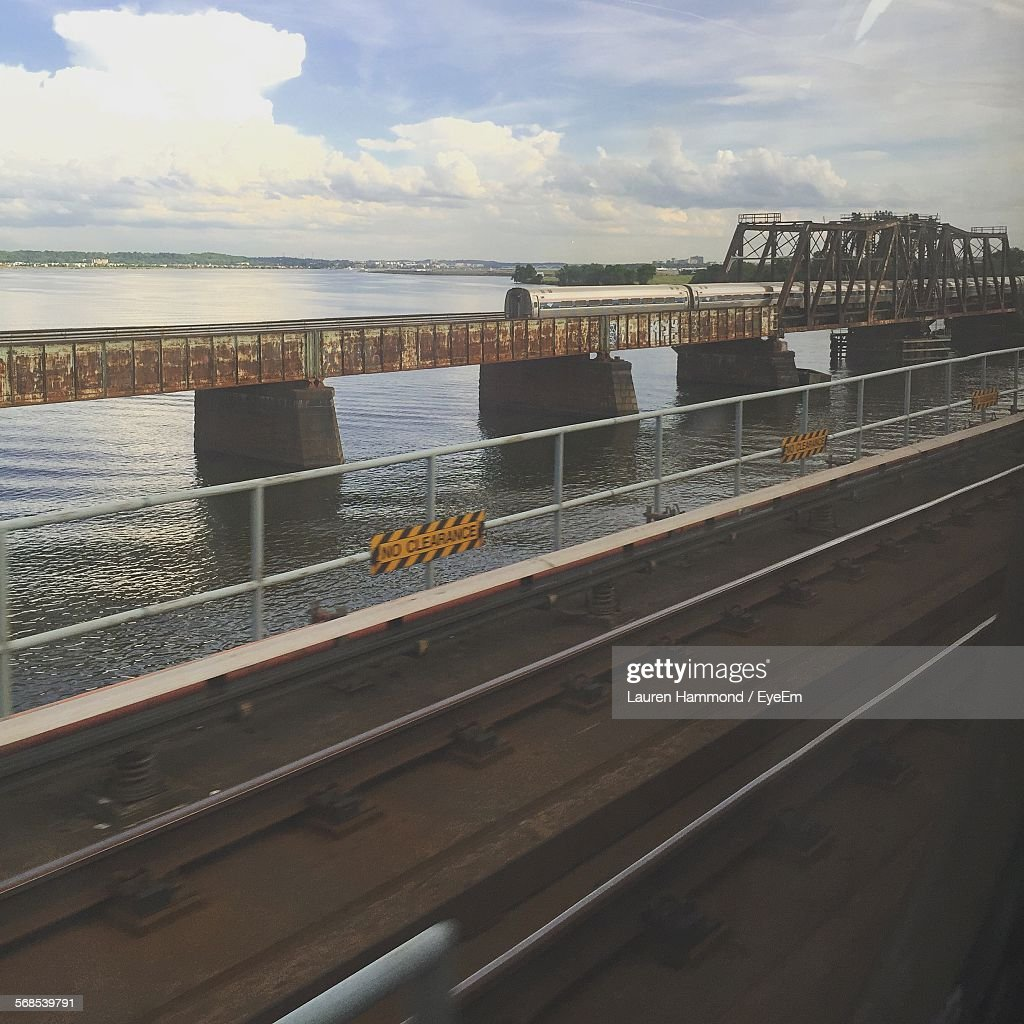 Railway Bridge Over Sea Against Sky : Stock Photo