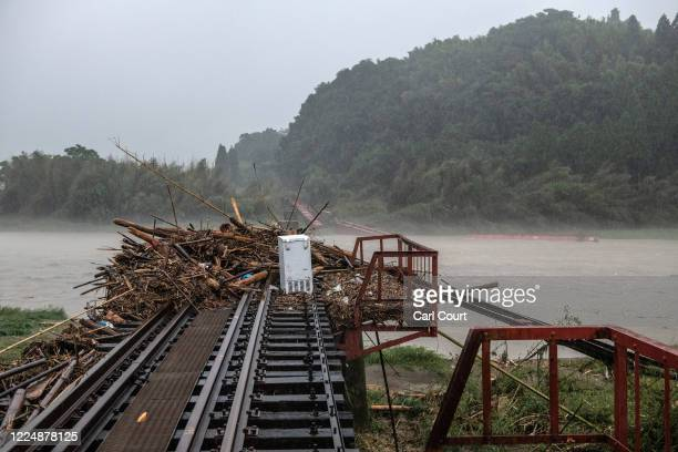 Railway bridge over the Kuma River is destroyed after torrential rain caused the river to burst its banks, on July 5, 2020 in Hitoyoshi, Japan....