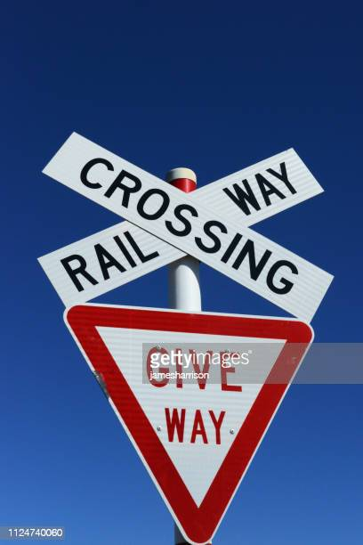 railway crossing and give way sign, new zealand - give way stock pictures, royalty-free photos & images