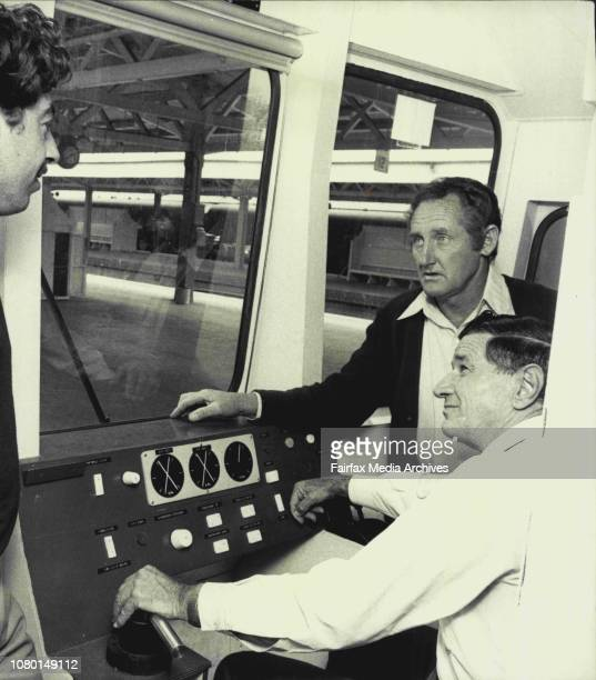 Railway employees Paul Greenwood electrician of Lakemba Jim McAloon driver of Revesby and seated at the controls Laurie Anderson driver of...