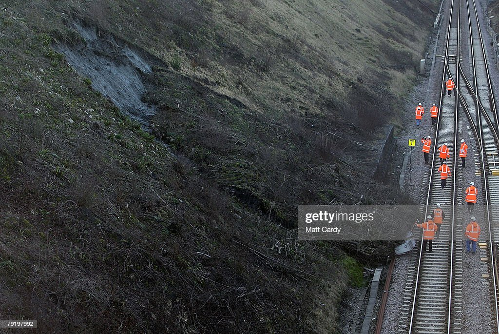 Railway engineers inspect the damage caused by a landslide on the London to South Wales train line near Chipping Sodbury, on January 24, 2008 in South Gloucestershire, United Kingdom. The closure of the line will bring major disruption to train services to Wales and the line is likely to be closed for several days while repairs are under taken.