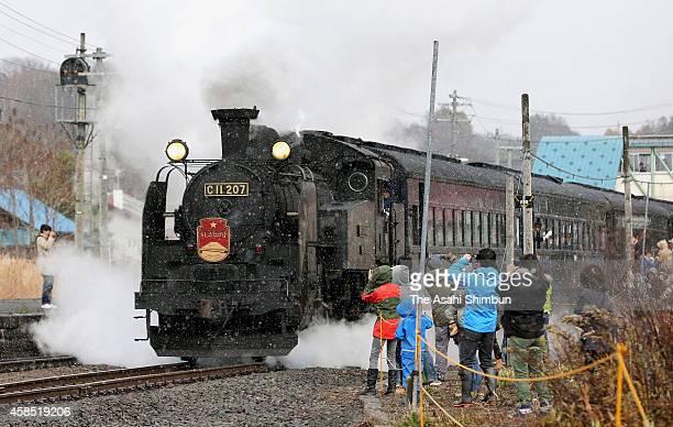 Railway fans take photographs of the final run of the SL Niseko at Niseko station on November 3 2014 in Niseko Hokkaido Japan