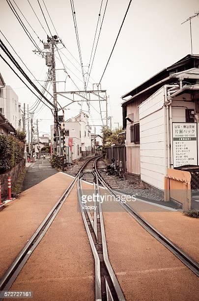 railway in town, enoshima, japan - vsojoy stockfoto's en -beelden