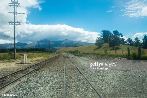 railway line near akaroa, new zealand - claire plumridge stock pictures, royalty-free photos & images