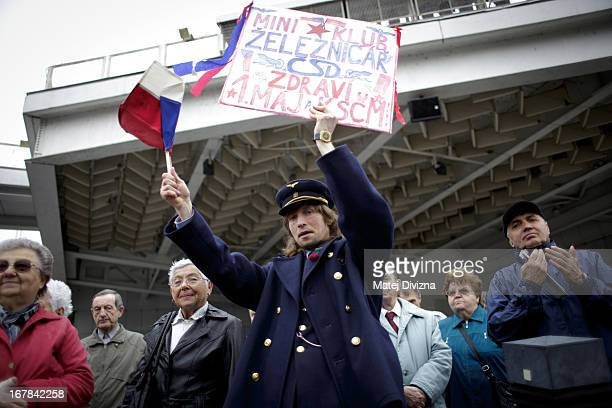 A railway man holds a banner as other members of the Czech opposition Communist party clap as they celebrate May Day on May 1 2013 in Prague Czech...