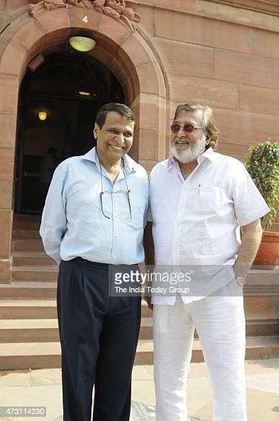 Railway minister Suresh Prabhu and Vinod Khana at Parliament during Parliament Budget Session