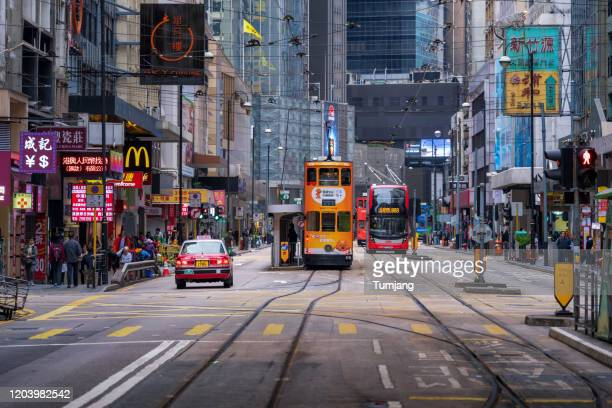 "railway of hongkong tramway near the international finance centre, abbreviated as ifc (branded as ""ifc"") is a skyscraper and an integrated commercial development of hong kong's central district. - hong kong stock pictures, royalty-free photos & images"