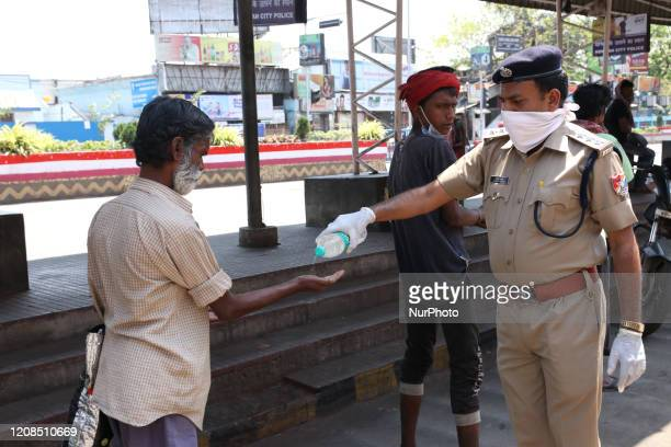 Railway Protection Force Sanitation before distribute Free Food to Migrant workers outside Howrah railway station during a government-imposed...