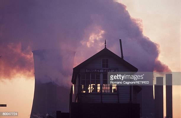 Railway signal box at Tinsley East Junction near Sheffield, with factory chimneys and cooling towers in the background, circa 1975.