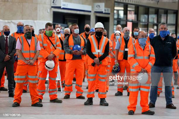 Railway staff and members of the public observe a minute's silence at Queen Street Station, to remember those who lost their lives, and all others...