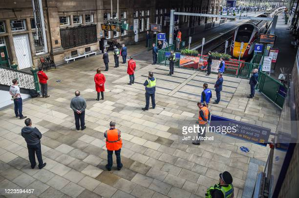 Railway staff at Waverley Station mark the 75th anniversary of VE day with a twominute silence on May 08 2020 in Edinburgh United KingdomThe UK...
