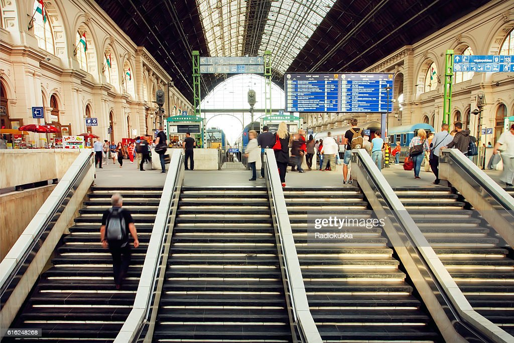 Railway station and people waiting for train : Stock Photo