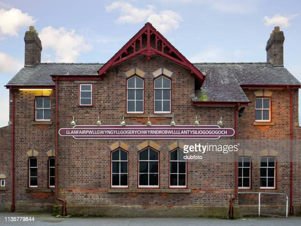 railway station at llanfairpwllgwyll on the island of anglesey, uk. - menai straits stock pictures, royalty-free photos & images