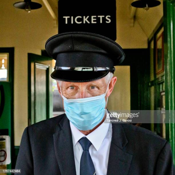 railway station worker wearing face mask - bavosi stock pictures, royalty-free photos & images