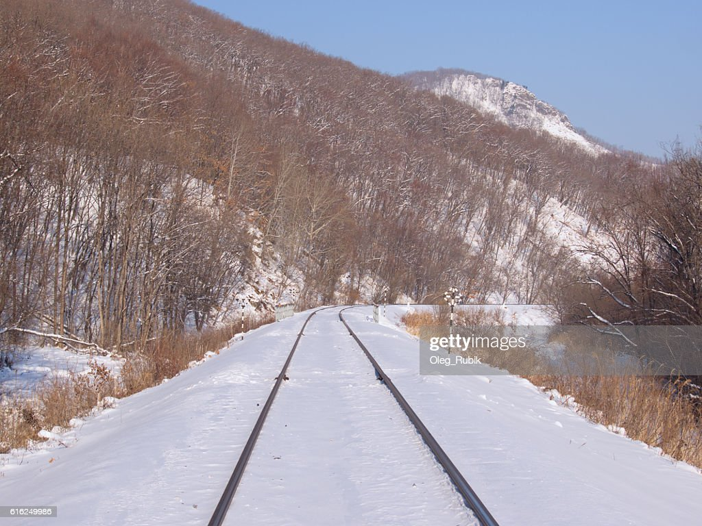 Railway track at a mountain slope : Stock Photo