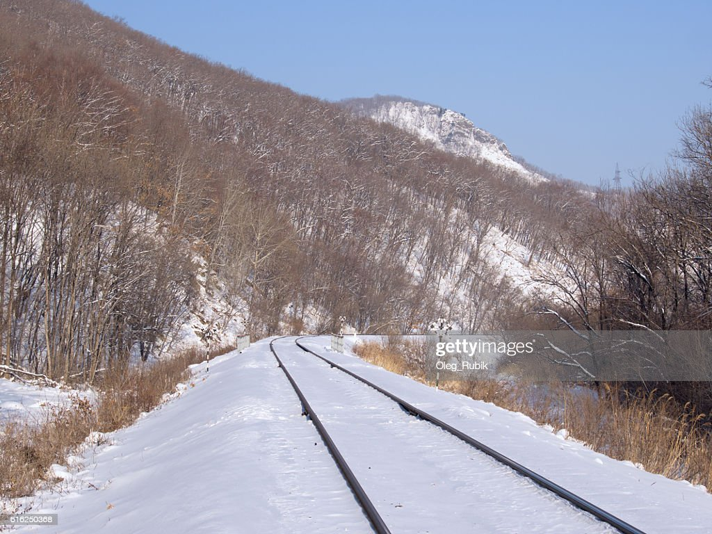 Railway track at a mountain slope : Foto de stock