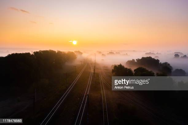 railway track at sunrise in the fog. view from the drone. - ukraine landscape stock pictures, royalty-free photos & images