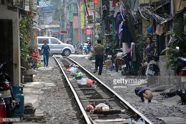 railway track through the old quarter of hanoi, vietnam - urinating stock pictures, royalty-free photos & images