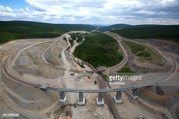 Railway tracks for mining operations cross a clearing in the taiga forest towards the Elga coal complex operated by OAO Mechel near Elga Sakha...