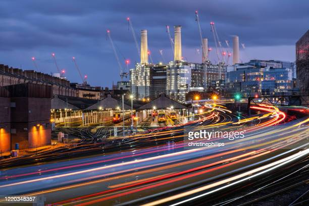 railway tracks leading to battersea power station, london, england, uk - former stock pictures, royalty-free photos & images