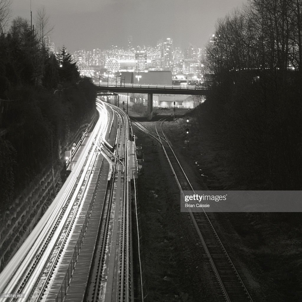 Railway tracks leading to city skyline of Vancouver, British Columbia, Canada : Stock Photo