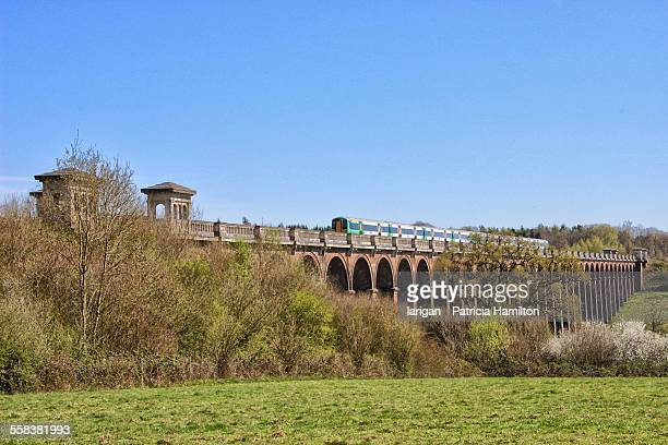 Railway train crossing the Balcombe Viaduct