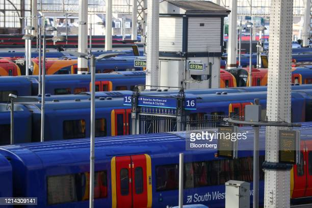 Railway trains, operated by South Western Railways run by the FirstGroup Plc and MTR Corp. Ltd. Franchise, sit at platforms at London Waterloo...