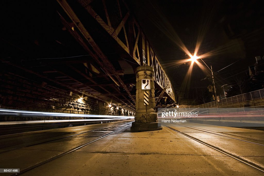 Railway underpass showing the passage of cars. : Stock Photo